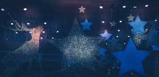 Christmas winter new year holidays Dark night background with Christmas stars lights spotlights with blue pink lilac lights. New year Christmas winter holidays royalty free stock images