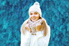 Christmas, winter and people concept - happy pretty girl in hat Stock Photos