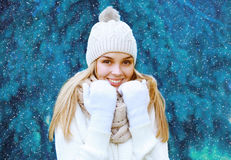 Christmas, winter and people concept - pretty woman outdoors Stock Image