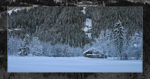 Christmas winter snow landscape. Christmas mountain landscape with snow and trees and a cabin in Switzerland royalty free stock images