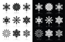 Christmas or winter Snowflakes  icons. Snowflakes icons with shadow on black and white background Stock Images