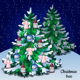 Christmas winter snowy tree with ornaments forest Royalty Free Stock Images