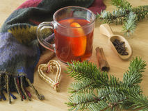 Christmas winter still life hot red tea with lemon woolen scarf Royalty Free Stock Image