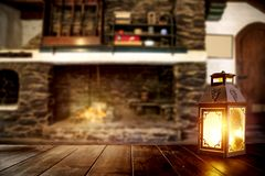 Free Christmas Winter Time, Moody Burning Lantern On Wooden Table. Space For Your Text Or Decoration. Old Fireplace Wall Background. Stock Image - 163977011