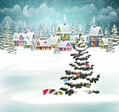 Christmas winter village. Village winter landscape with snow-covered houses and christmas tree with Christmas decorations Stock Photos