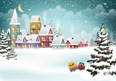 Christmas winter village. Village winter landscape with snow covered houses and  christmas tree with Christmas presents Royalty Free Stock Image
