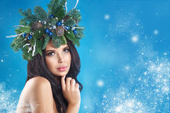 Christmas Winter Woman. Beautiful New Year and Christmas Tree Royalty Free Stock Photography