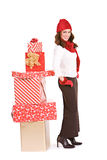 Christmas: Winter Woman Standying By Stack of Gifts Stock Images