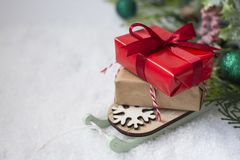 Free Christmas Winter Wooden Sleigh With Gift Boxes, Over The Snow. Abstract Winter Greeting Card With Copy Space Royalty Free Stock Photo - 162115235