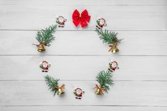 Christmas winter wreath, round frame . Christmas decorations. On white wooden background. Wallpaper, background or holiday art. Top view, place for text, flat royalty free stock photography