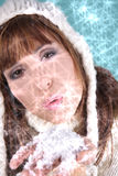 Christmas wintr eve. Woman blowing snow for christmas cold holiday royalty free stock image