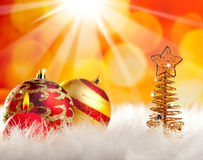 Christmas wire tree with candle and baubles Stock Image