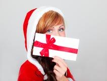 Christmas wish. Santa woman with christmas wishing coupon bonus list Royalty Free Stock Image