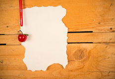 Christmas wish list background. Parchment for a Christmas wish list against a rustic wooden background Stock Photo