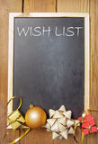 Christmas wish list. Wish list background with space handwritten on a chalkboard with christmas decorations Royalty Free Stock Image