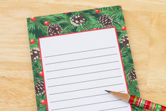 Christmas Wish List, Christmas Wish List with pencil and copy-space royalty free stock photo