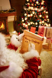 Christmas wish list. In Santa's hands Stock Images