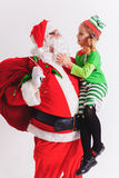 Christmas Wish 2016. Santa Claus and Little Girl. Telling Wishes Royalty Free Stock Image