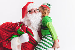 Christmas Wish 2016. Santa Claus and Little Girl. Telling Wishes Stock Image
