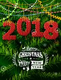 New Year 2018 in shape of knitted fabric against pine branches Stock Photos