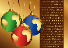 Christmas wishes in different languages. And balls with globe Royalty Free Stock Images