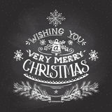 Christmas wishes hand-lettering with chalk. Vintage hand-lettering Christmas wishes with chalk on blackboard background, greeting card Royalty Free Stock Photography