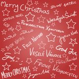 Christmas wishes. Merry Christmas - season wishes doodle in multiple languages. Christmas background Royalty Free Stock Photography