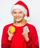 Christmas wishes. Rich girl with lemon and money. Woman lemon millionaire. Lemon money concept. Girl santa hat drink. Juice lemon straw while hold pile of money stock photo