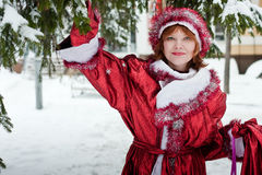 Christmas woman. Woman dressed like santa claus with sack with gifts in hand Stock Images
