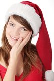 Christmas woman. Wearing a santa hat, isolated on white background Royalty Free Stock Photo