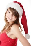 Christmas woman. Wearing a santa hat, isolated on white background Royalty Free Stock Images