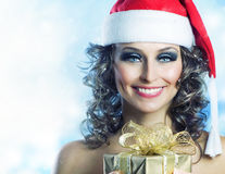 Christmas Woman. Santa Girl with Gift Box. Christmas Stock Image