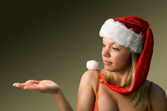 Christmas woman-3. Surprised attractive woman with a Santa's hat Royalty Free Stock Image
