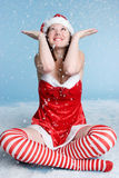 Christmas Woman. Christmas santa woman in snow royalty free stock photo