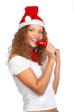 Christmas woman. In a Santa Cap. Isolated over white background royalty free stock photography