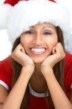 Christmas woman. In a Santa Cap. Isolated over white background stock photography