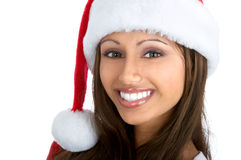 Christmas woman. In a Santa Cap. Isolated over white background royalty free stock photos