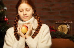Christmas woman with apple. Stock Photo