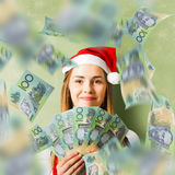 Christmas woman with Australian dollar money fan Royalty Free Stock Photo