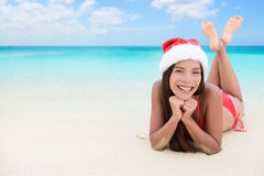 Christmas woman on beach winter vacation Stock Photography
