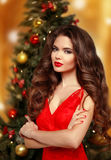 Christmas woman. Beautiful smiling girl model. Makeup. Healthy l Royalty Free Stock Photography