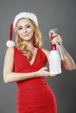 Christmas woman beautiful smiling with glass of champagne santa' Royalty Free Stock Photos