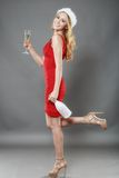 Christmas woman beautiful smiling with glass of champagne santa' Royalty Free Stock Image