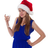 Christmas woman beautiful smiling with glass of champagne santa's hat isolated Stock Photography
