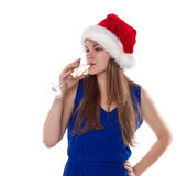 Christmas woman beautiful smiling with glass of champagne santa's hat isolated Stock Photos