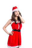 Christmas Woman. Beauty Asian Model Girl in Santa Costume isolat Royalty Free Stock Photo