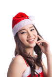 Christmas Woman. Beauty Asian Model Girl in Santa Hat isolated o Royalty Free Stock Photography