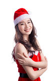 Christmas Woman. Beauty Asian Model Girl in Santa Hat isolated o Stock Photography