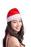 Christmas Woman. Beauty Asian Model Girl in Santa Hat isolated o Royalty Free Stock Photos