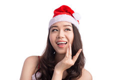 Christmas Woman. Beauty Asian Model Girl in Santa Hat Thinking S. Omething Stock Photo
